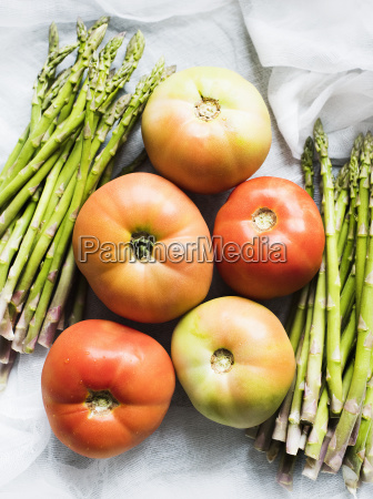 still life of asparagus and tomatoes