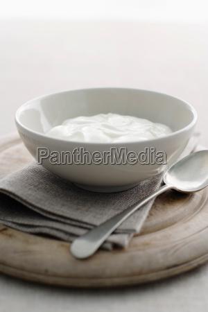 bowl of yogurt on wooden board