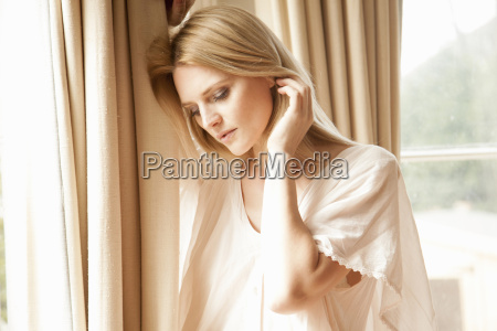 beautiful mid adult woman with hands