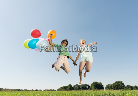 girl and boy holding bunch of