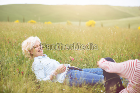 two mature female friends sitting in