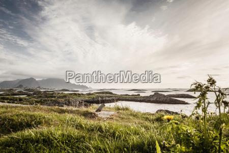 clouds over rocky coastline