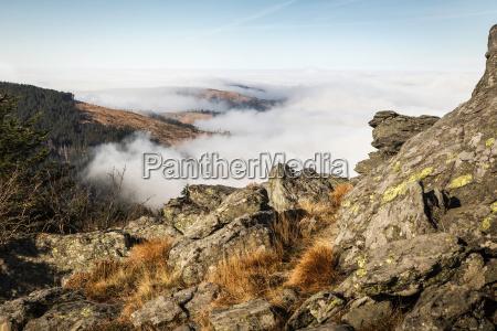 low clouds over rural landscape