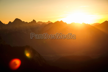 silhouette of mountains at sunset