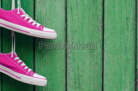 pair of bright pink sports sneakers
