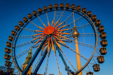 ferris wheel and towers under blue