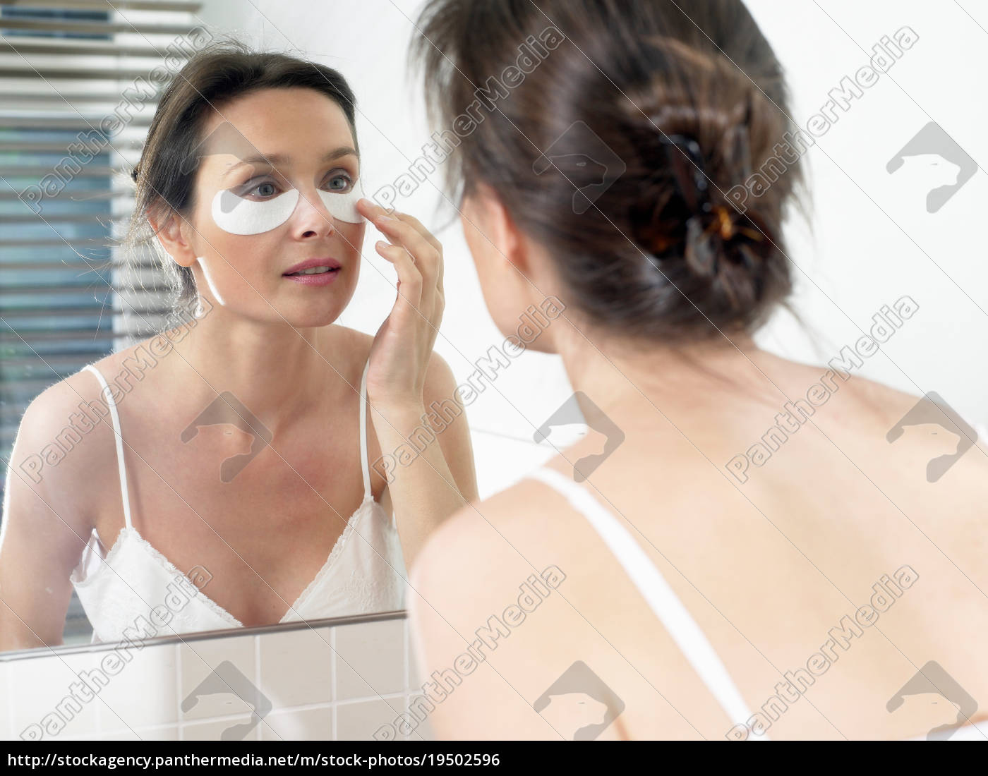 woman, in, bathroom, , applying, a, face - 19502596