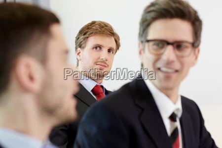 headshot of businessmen smiling