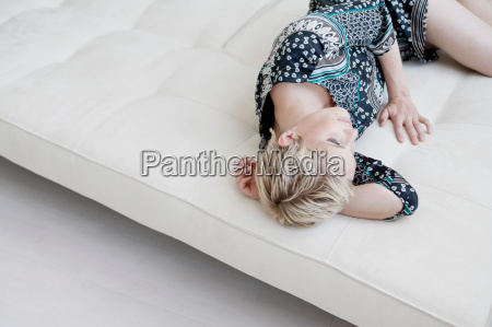 woman on sofa talking on cell