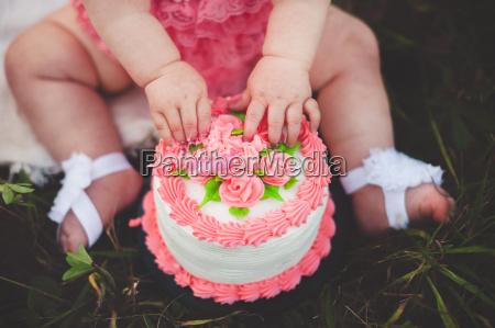 cropped shot of baby girl sitting
