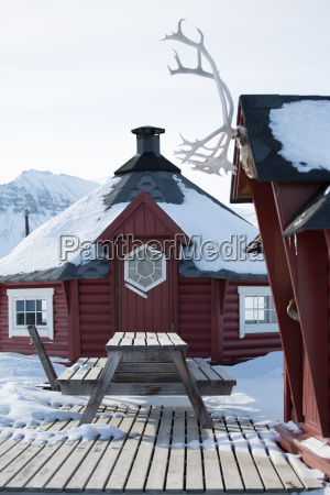 traditional wooden house and picnic bench