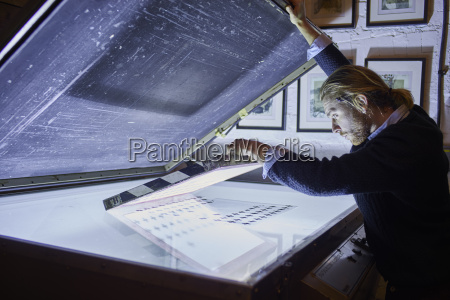 young man preparing screen frame on