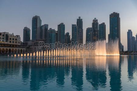 sunlit fountains in lake dubai united