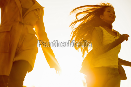 two young female friends running in