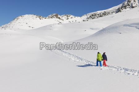 couple, walking, in, snow, , kuhtai, , austria - 19512944