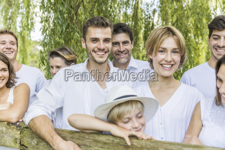 portrait of group of people leaning