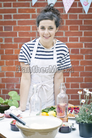 portrait of young woman preparing food