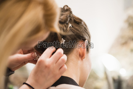 close up of woman placing hair