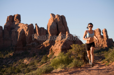 woman running in rural landscape