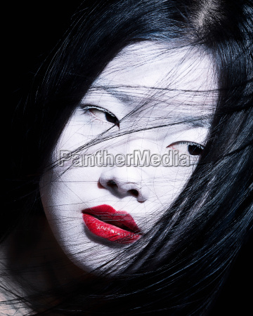 young woman with dramatic makeup white