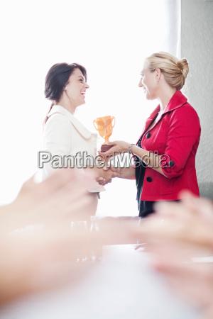 businesswoman receiving award