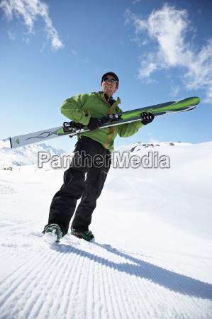 skier on snow covered hillside
