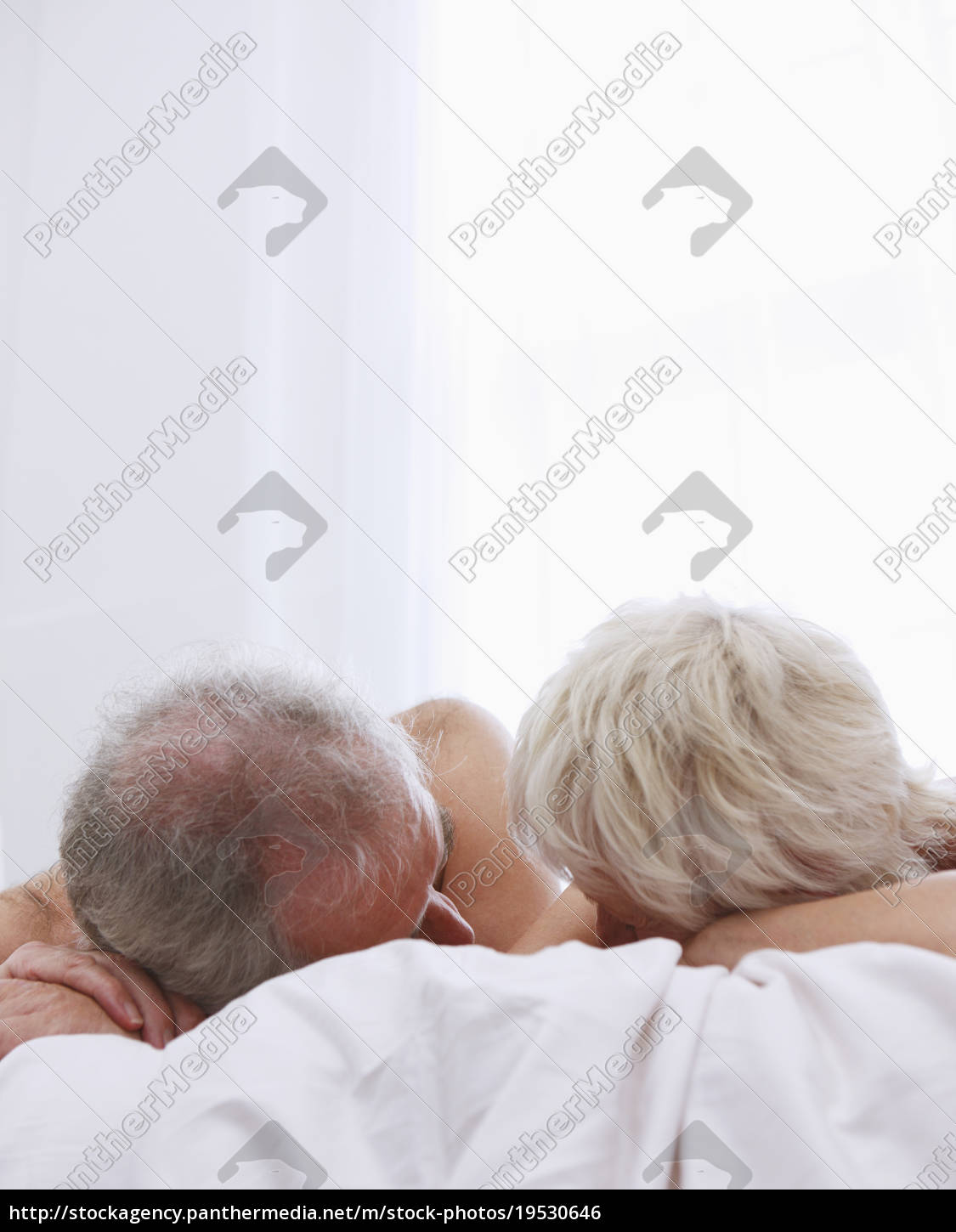 senior, couple, relaxing, in, bed - 19530646
