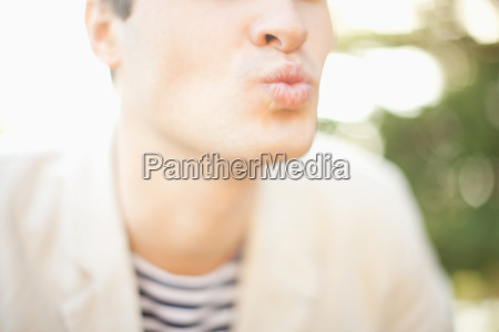 young man blowing a kiss