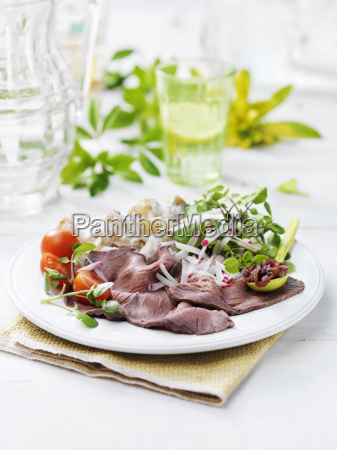 plate of natural salad with roast
