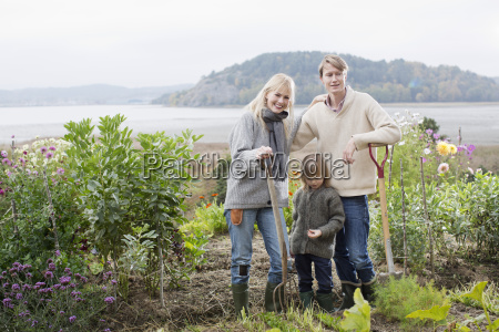 portrait of couple and son digging