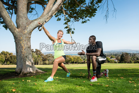 young woman and trainer with lunge