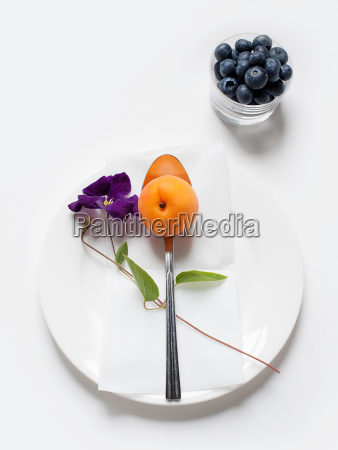 still life with apricot and blueberries