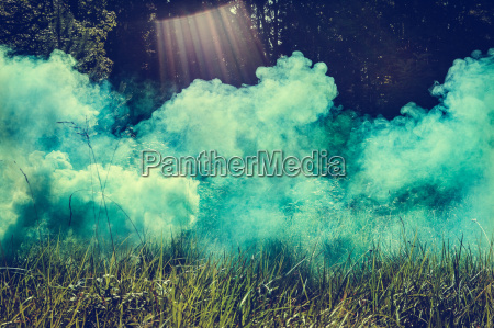 close up of turquoise smoke cloud