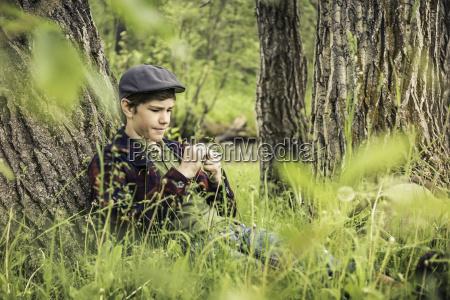 teen boy wearing flat sitting leaning