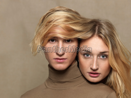 young woman covering mans head with