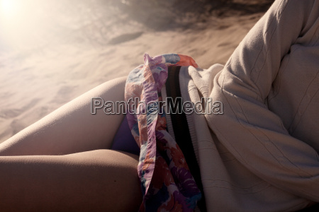 young woman lying on beach close