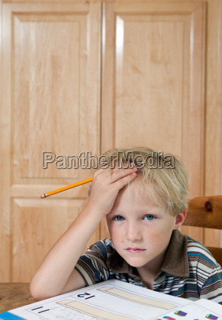 boy looking confused over homework portrait