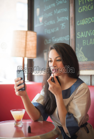 mid adult women using mobile phone