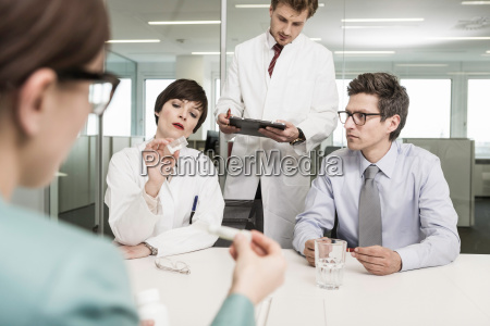 people in meeting with scientist