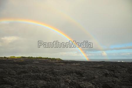 double rainbow over kilauea lava flow
