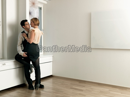 couple caressing in office