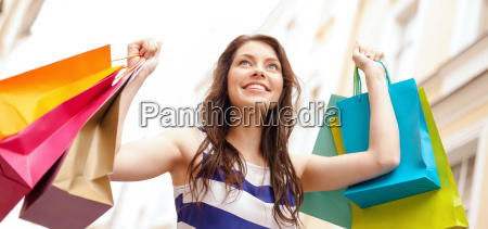 beautiful woman with shopping bags in