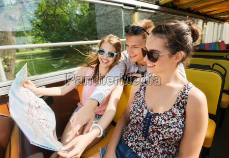 group of smiling friends traveling by