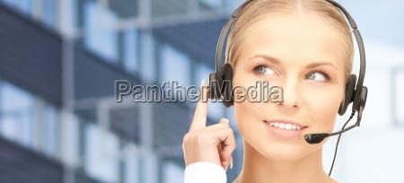 helpline operator in headset over business