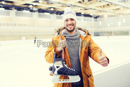 happy young man showing thumbs up