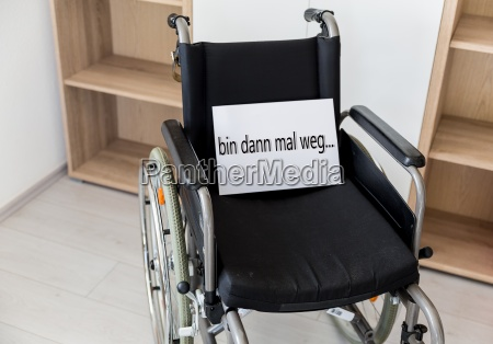 an empty wheelchair stands in front