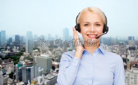 helpline operator in headset over city