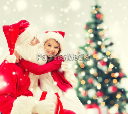 smiling girl with santa claus and