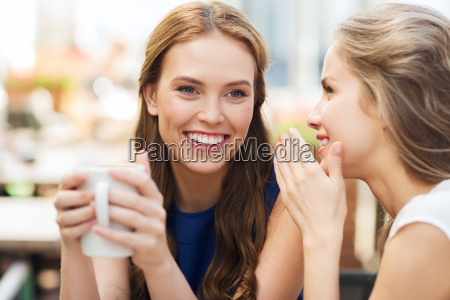 young women drinking coffee and talking