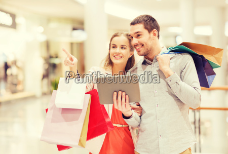 couple with tablet pc and shopping